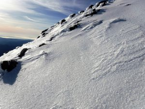 Ice exposed by wind scouring at 6800 feet