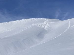 Natural wind slab avalanche (D1) on an east aspect at 6200ft