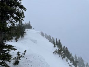 Active wind transport  and cornice growth occurring at ridge lines in the Crystal Backcountry