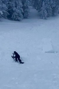 This bystander was taking photos when the Tuesday avalanche was triggered by another skier. He fell uphill of the sliding soft slab onto the bed surface and slid down the bed surface just behing the moving snow. Came to rest among large soft slab chunks.