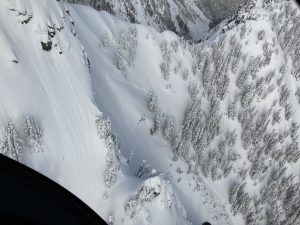Natural small loose dry (point release, sluff) avalanches off steep rocky spots from recent low density snowfall, and a crown is noticeable from a recent slab avalanche as well off Helena Peak.
