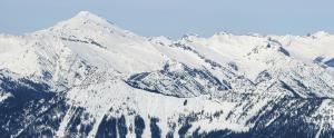 Large glide crack present on the S aspect of Wenatchee Ridge - Glacier Peak in the background. (3/12)