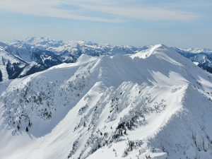Cornices looming on east aspects of Rock Mountain (3/12)
