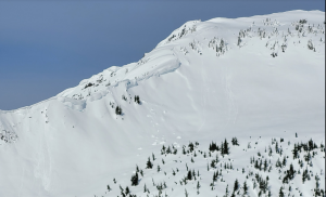 Debris from a recent cornice fall as well as loose wet debris on the SE aspect of the ridge leading up to the south summit of Rock Mountain (3/12)