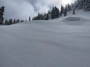 Wind drifted snow near ridge line