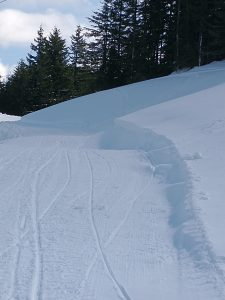 Fresh small Wind Drifts on the side of the groomed trail and some textured surfaces just out of view. Indicators that Wind Slabs could exist on specific terrain features