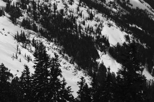 Pinwheels and glide cracks visible on west-facing slope.