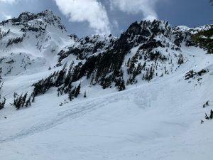 Debris field from slide in slopes above source lake