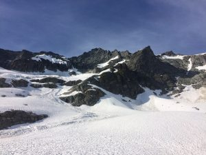 Avalanche debris extending to near the high bivy sites, around 6400'.